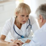Doctor with patient in office, nursing home