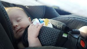 A sleeping baby in the car, car accident