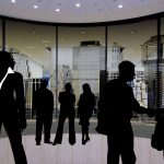 Shadow views of business people, worker compensation